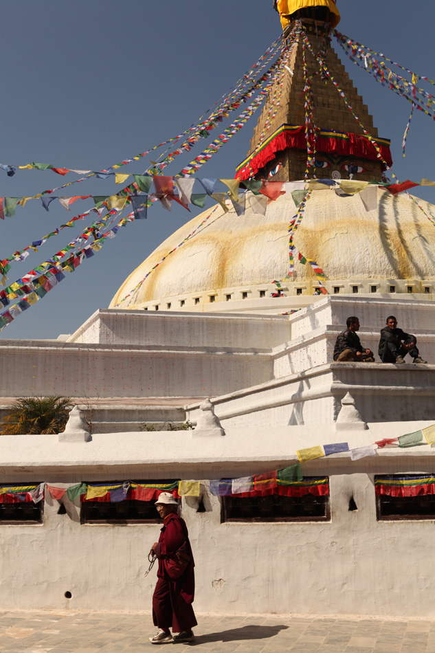 Monks and pilgrims by the Big Stupa in Kathmandu, Nepal