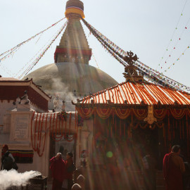 Buddhist monks and pilgrims by the Big Stupa in Kathmandu, Nepal