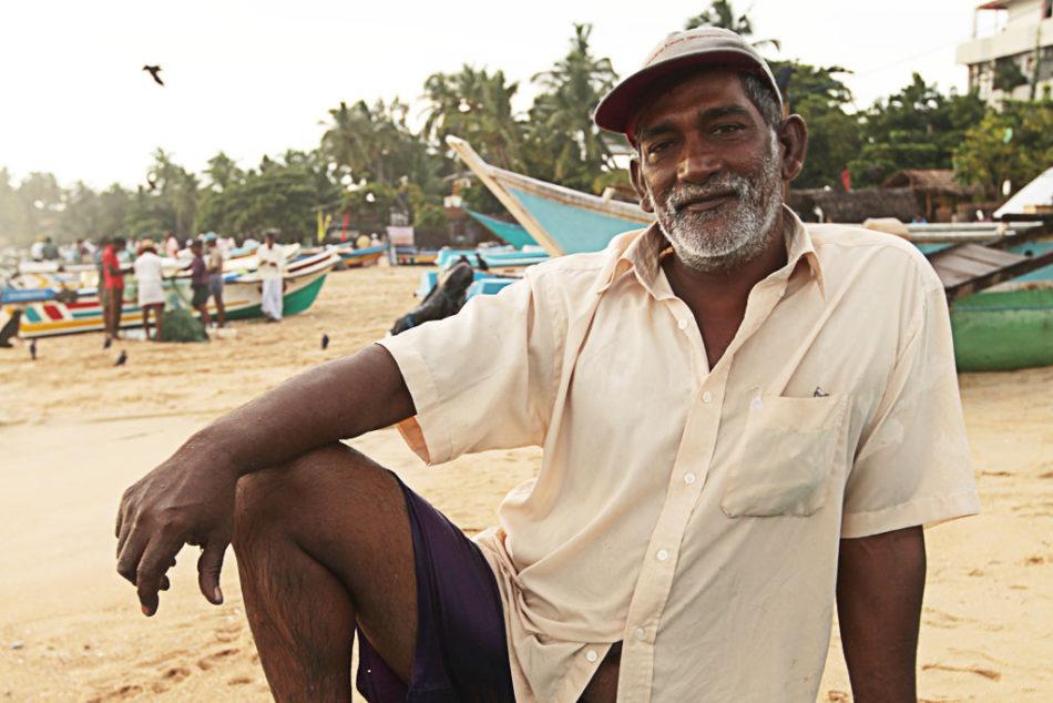 Photogenic fisherman at the beach in Arugam Bay.