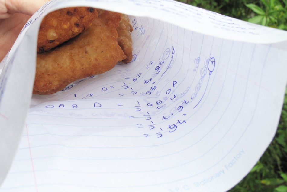 Tasty samosas served wrapped in school notes.