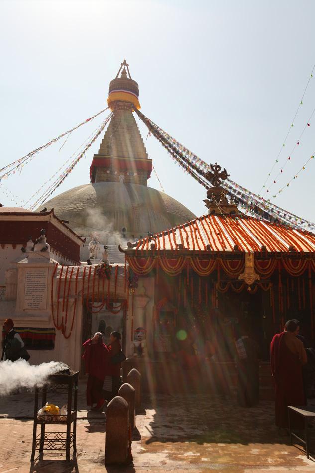 Buddhist monks and pilgrims by the Big Stupa in Kathmandu, Nepal